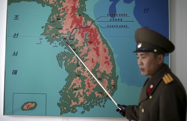 "A North Korean military official said in an interview with an international news agency, ""Tensions have increased significantly along the Demilitarized Zone since North Korea's fourth nuclear test and rocket launch."" According to the Associated Press (AP) that has a bureau in Pyongyang, North Korean People's Army Lt. Col. Nam Dong Ho said, ""Something could happen at any time. That's now truer than ever as tensions are escalating between Pyongyang, Seoul and Washington."" (Photo) Lt. Col. Nam points to a map showing the line which separates the two Koreas in Panmunjom at the Demilitarized Zone (DMZ). (AP=Newsis)"