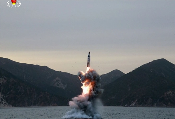 A submarine-launched ballistic missile (SLBM) being fired from waters southeast of Sinpo, South Hamgyong Province on April 23. (KCNA/Newsis)
