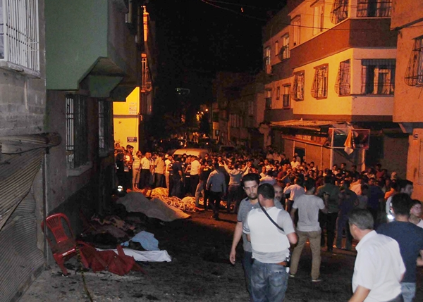 Citizens gather near cloth-covered victims of terror attack at a wedding hall downtown Gaziantep, Turkey, August 21. The Governor of Gaziantep (Ali Yerlikaya) defined the attack at the wedding area in Gaziantep in August 21 as terrorism.