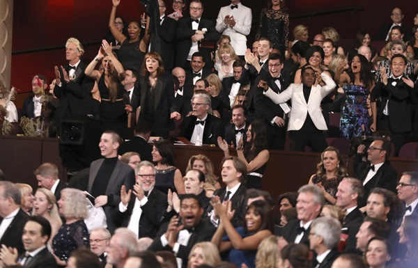 "The cast of ""Moonlight"" celebrates as ""Moonlight"" wins the best picture award at the Oscars on Sunday, Feb. 26, 2017, at the Dolby Theatre in Los Angeles. (Photo by Matt Sayles/Invision/AP=newsis)"