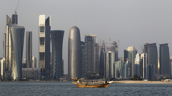 FILE - In this Thursday Jan. 6, 2011 file photo, a traditional dhow floats in the Corniche Bay of Doha, Qatar, with tall buildings of the financial district in the background. Qatar likely faces a deadline this weekend to comply with a list of demands issued to it by Arab nations that have cut diplomatic ties to the energy-rich country, though its leaders already have dismissed the ultimatum. (AP Photo/Saurabh Das, File=newsis)