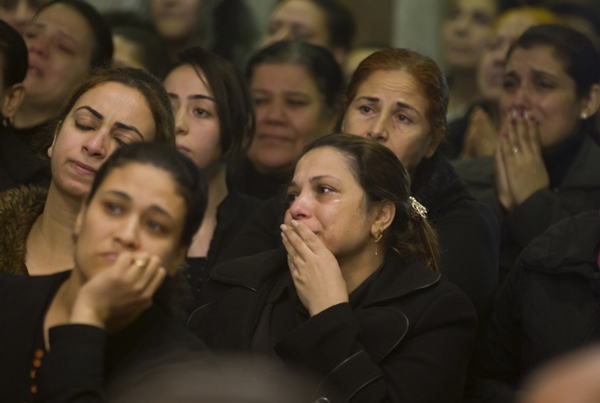 Relatives of Coptic Christians grieve as during the funeral service of victims of the attacked on Mar Mina church in Cairo, Egypt, Friday, Dec. 29, 2017. At least 10 people, including eight Coptic Christians, were killed after unidentified gunmen opened fire outside a church in a south Cairo suburb, Egypt's Health Ministry spokesman said Friday. (AP Photo/Amr Nabil=Newsis)