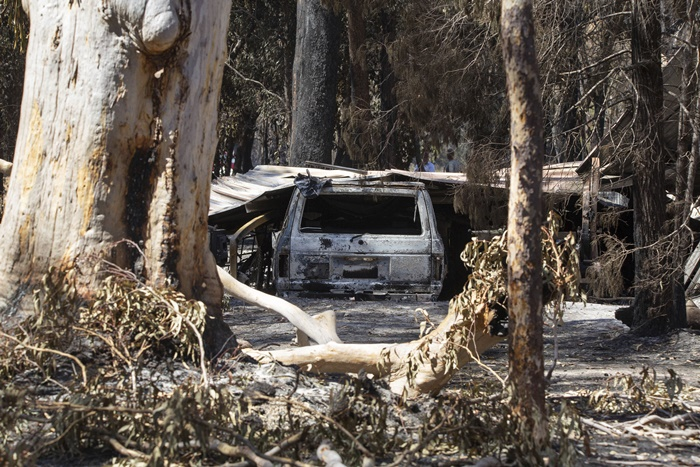 "Damage caused by bushfire is seen at resident Brian Williams' resort at Lake Cooroibah Road in Noosa Shire, Queensland, Australia, Monday, Nov. 11, 2019. Australia's most populous state New South Wales declared a state of emergency on Monday due to unprecedented wildfire danger as calls grew for Australia to take more action to plan for an counter climate change. New South Wales state Emergency Services Minister David Elliott said residents were facing what ""could be the most dangerous bushfire week this nation has ever seen."" (Rob Maccoll/AAP Images=Newsis)"