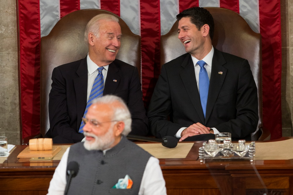 Vice President Joe Biden and House Speaker Paul Ryan of Wis., laugh as Indian Prime Minister Narendra Modi addresses a joint meeting of Congress on Capitol Hill in Washington, Wednesday, June 8, 2016. (AP Photo/Evan Vucci=Newsis)
