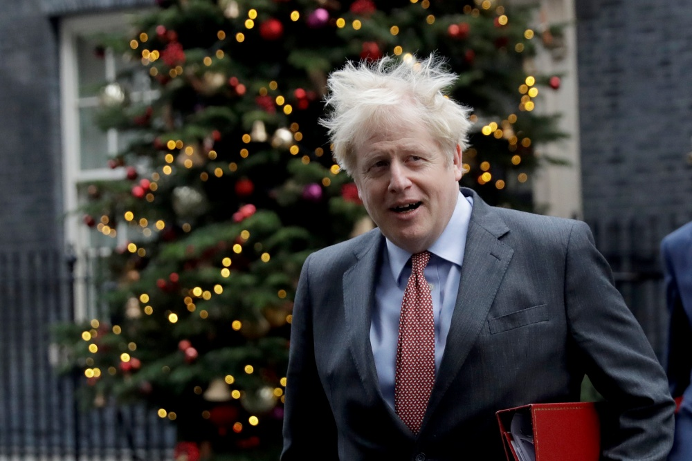 "British Prime Minister Boris Johnson leaves 10 Downing Street in London, to attend a cabinet meeting at the Foreign, Commonwealth and Development Office, Tuesday, Dec. 8, 2020. Britain's rollout of the COVID-19 vaccine on Tuesday has been dubbed ""V-Day,"" recalling the World War II D-Day landings that marked the start of the final push to defeat Nazi Germany. The U.K. is the first Western country to authorize widespread use of a vaccine. (AP Photo/Matt Dunham=Newsis)"