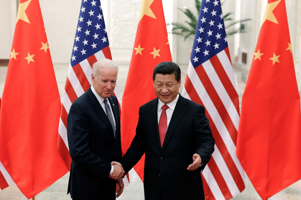 FILE - In this Dec. 4, 2013, file photo, Chinese President Xi Jinping, right, shakes hands with then U.S. Vice President Joe Biden as they pose for photos at the Great Hall of the People in Beijing. (AP Photo/Lintao Zhang, Pool, File=Newsis)